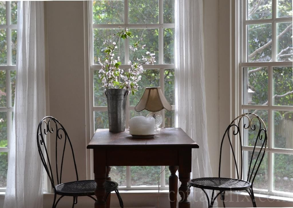 Cottage Fix blog - cherry blossom branches in a metal vase on our sun porch